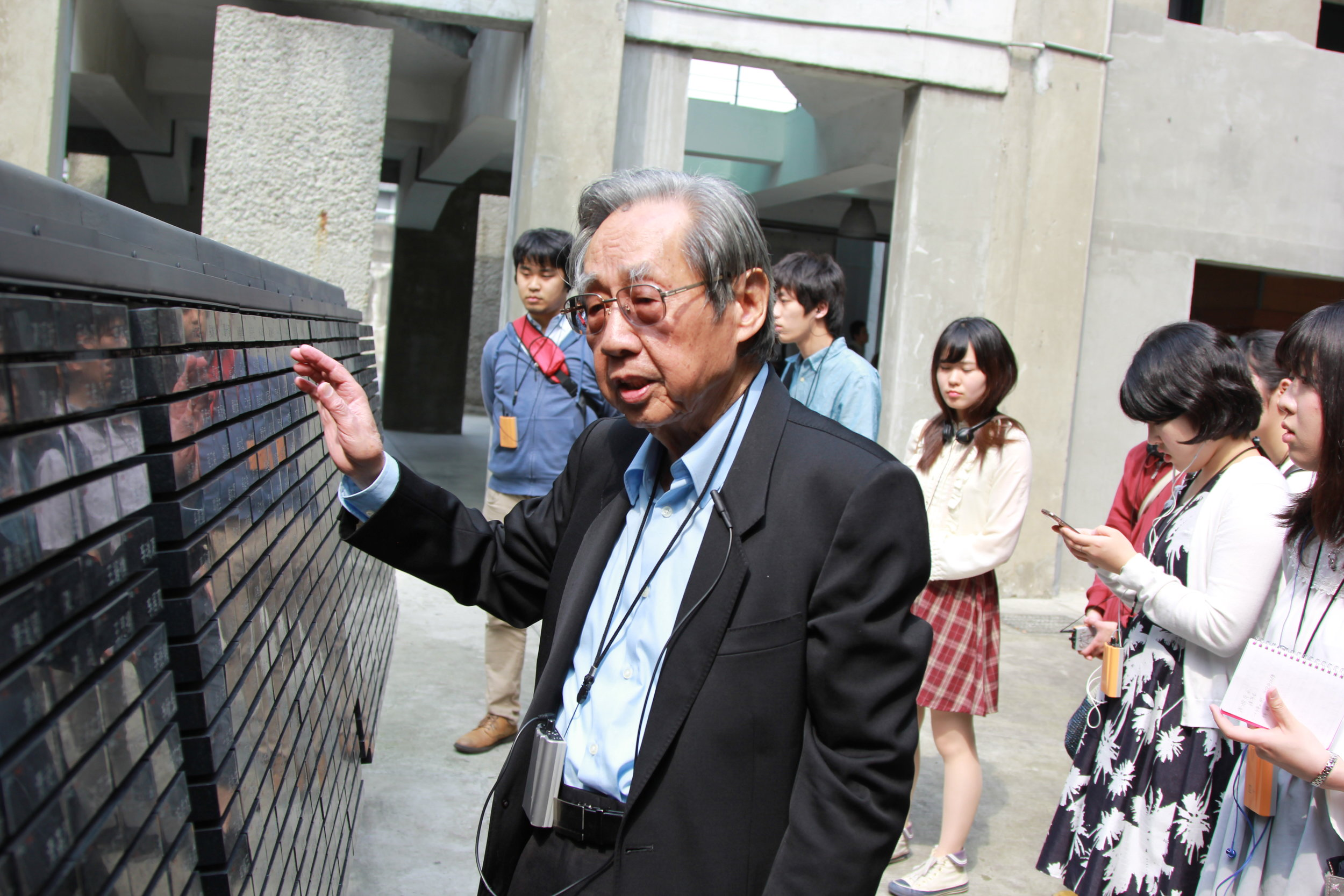 Mr Tsai Kunlin guides the students around the Jingmei Human Rights Museum