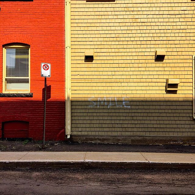 SMILE. . Who else is guilty of scrolling with a major resting bitch face?🙋🏻 . #smile #color #colorblock #warmtones #streetlevel #charlottetown #pei #reminder #happygraffiti #peiphotographer #wandering