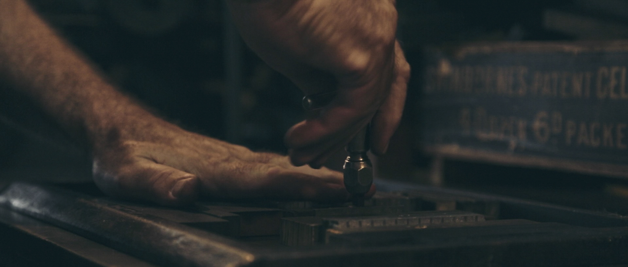 Pressed letters frame 5_screw hands.jpg
