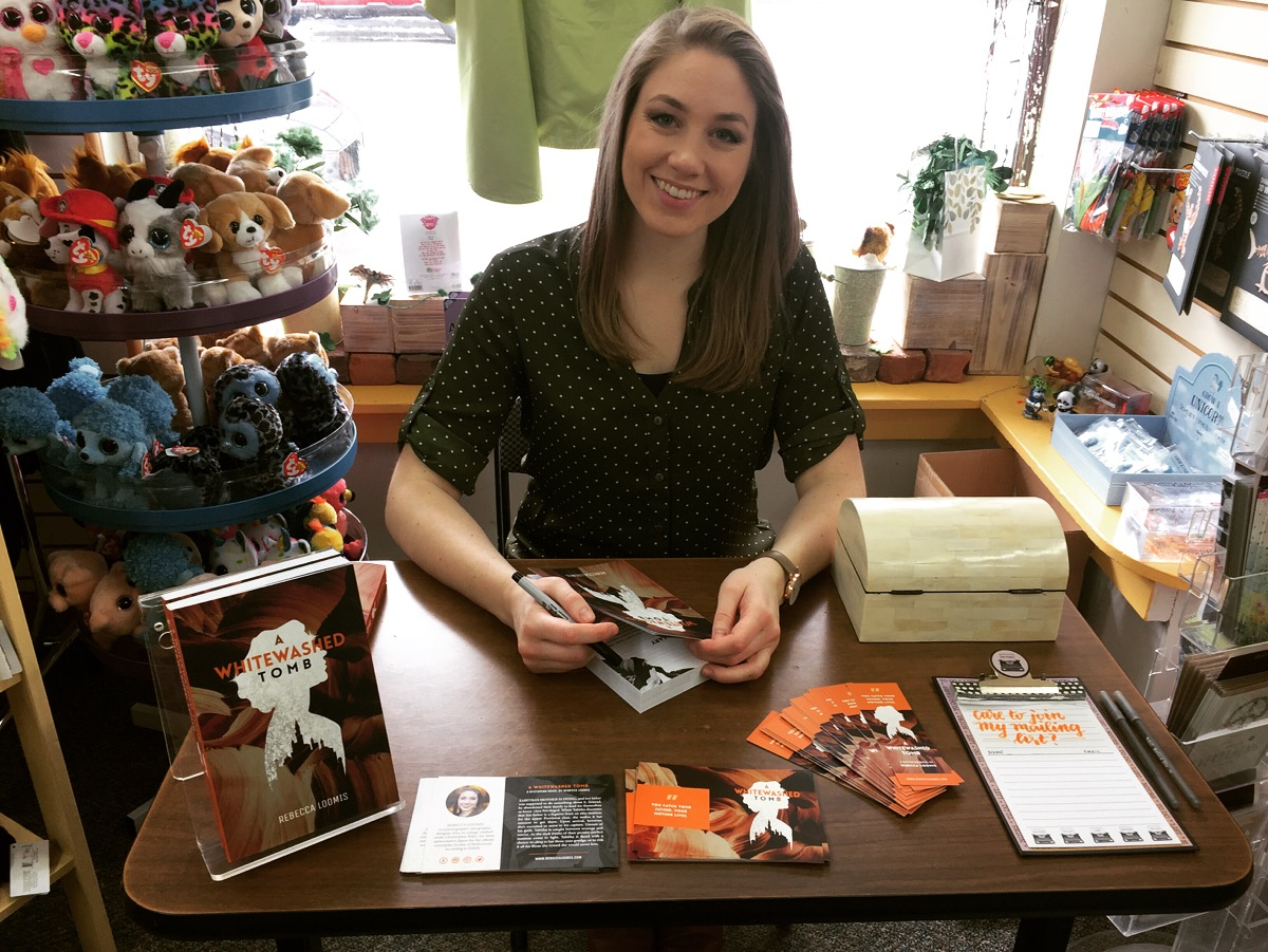 Rebecca Loomis, author of  A Whitewashed Tomb , signs books at Linda's Office Supplies in Goshen, NY.
