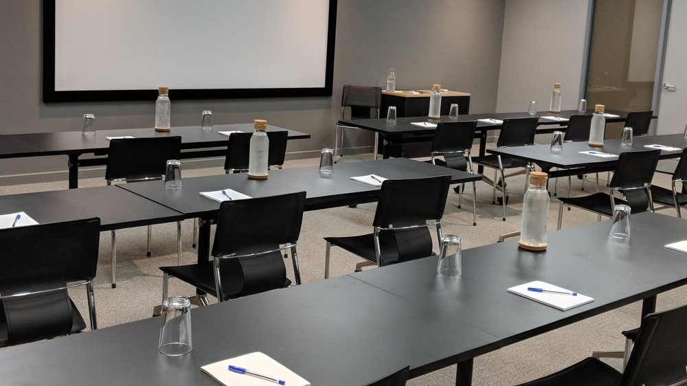 Conference Area - Full access to room and all amenities while the room is booked. Access to help desk and support staff to assist with AV and connectivity.Tea and Coffee with basic snacks servedAccess to bathrooms and kitchen areaLearn More →