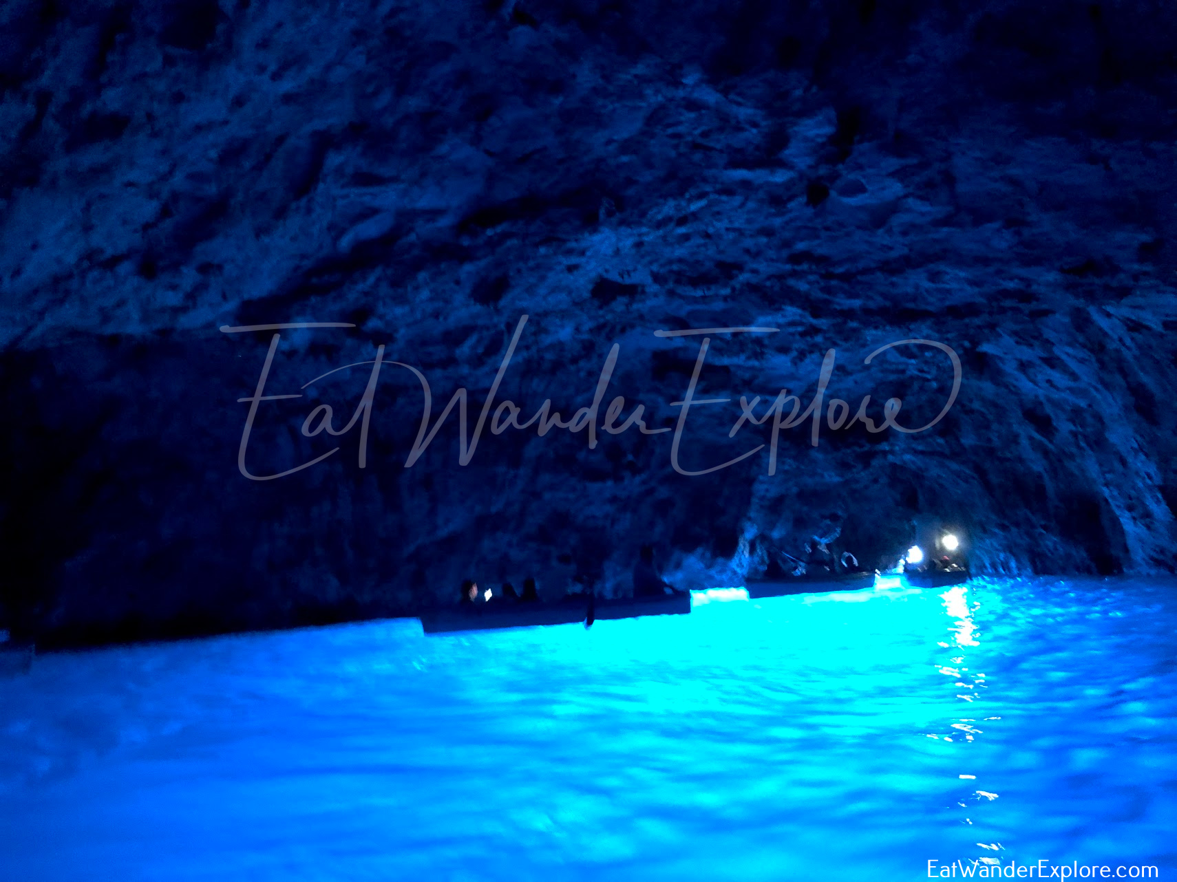 Boats inside of the Blue Grotto