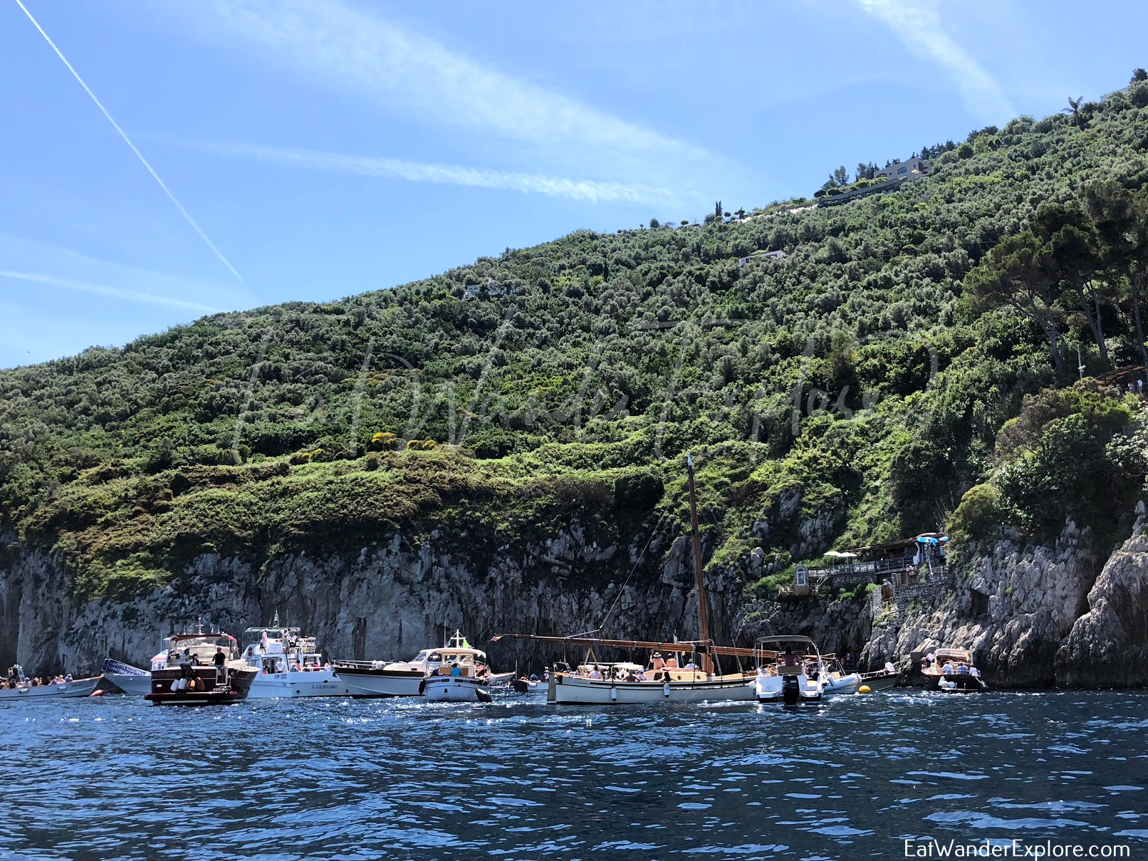 boats waiting outside of the Blue Grotto