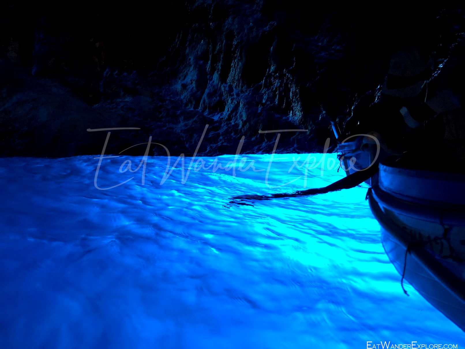 boat in the blue grotto and glowing water