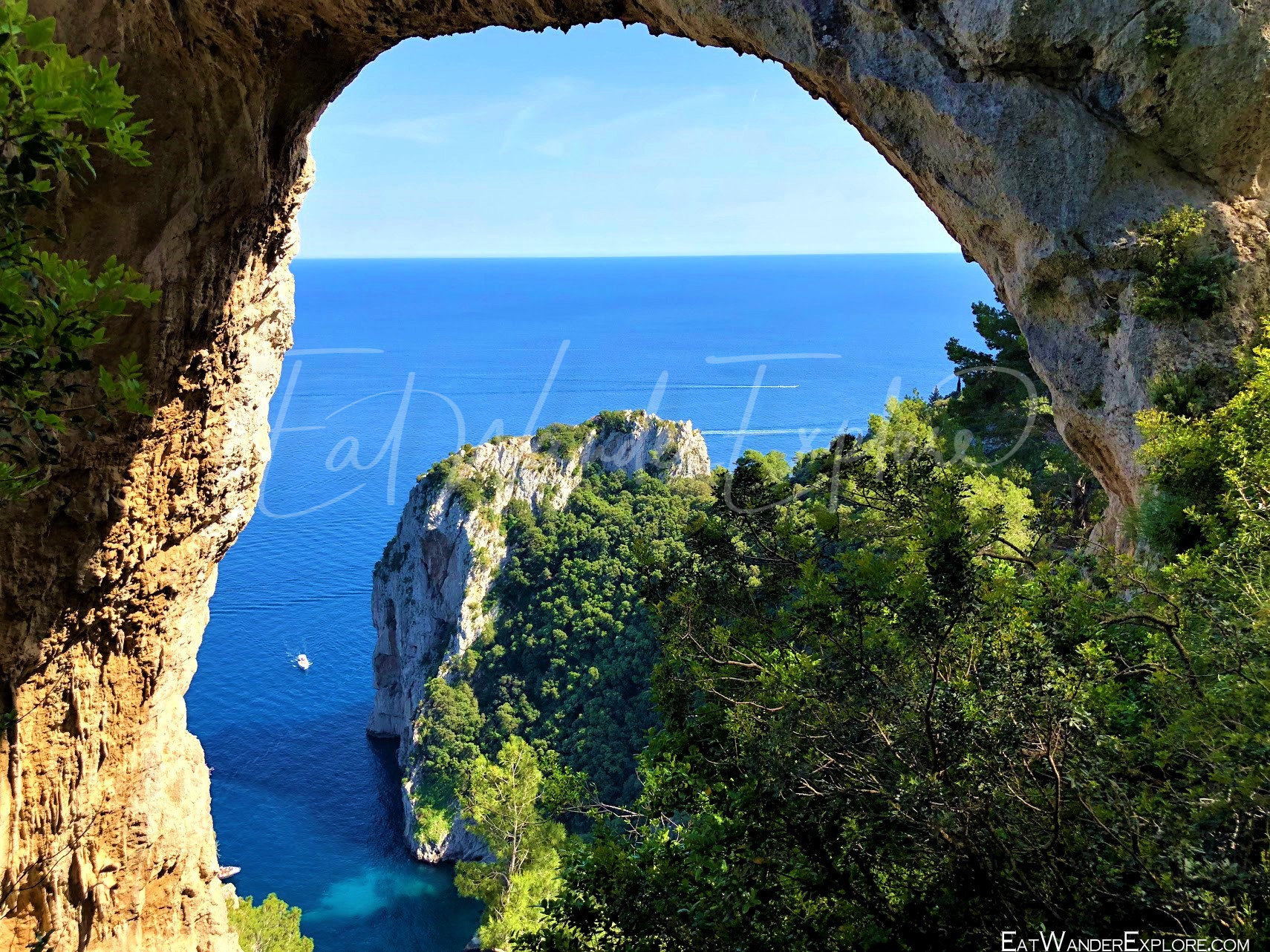 Looking through the natural Arch on Capri Italy
