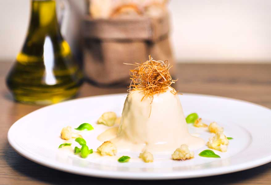 Cauliflower flan, toma raschera cheese fondue, crispy leek -