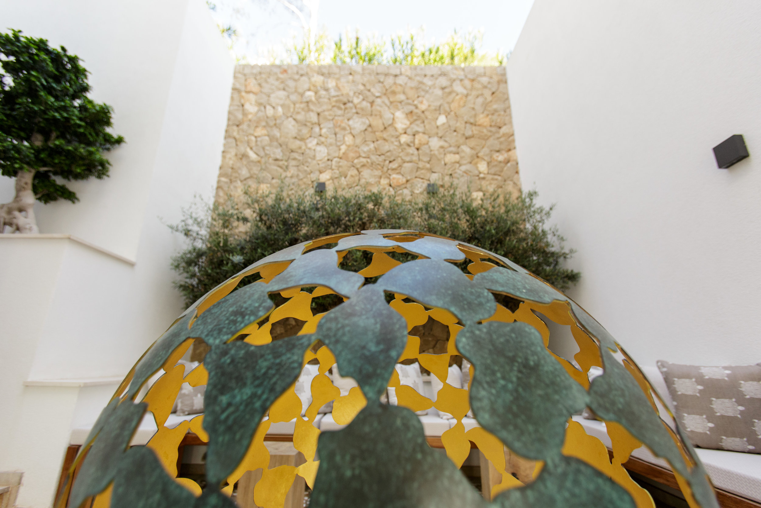 The Mantle - Commissioned from  David Harber .  Made from hundreds of bronze petals and 24 carat gold interior,linked into a cellular latticework of turquoise verdigris.