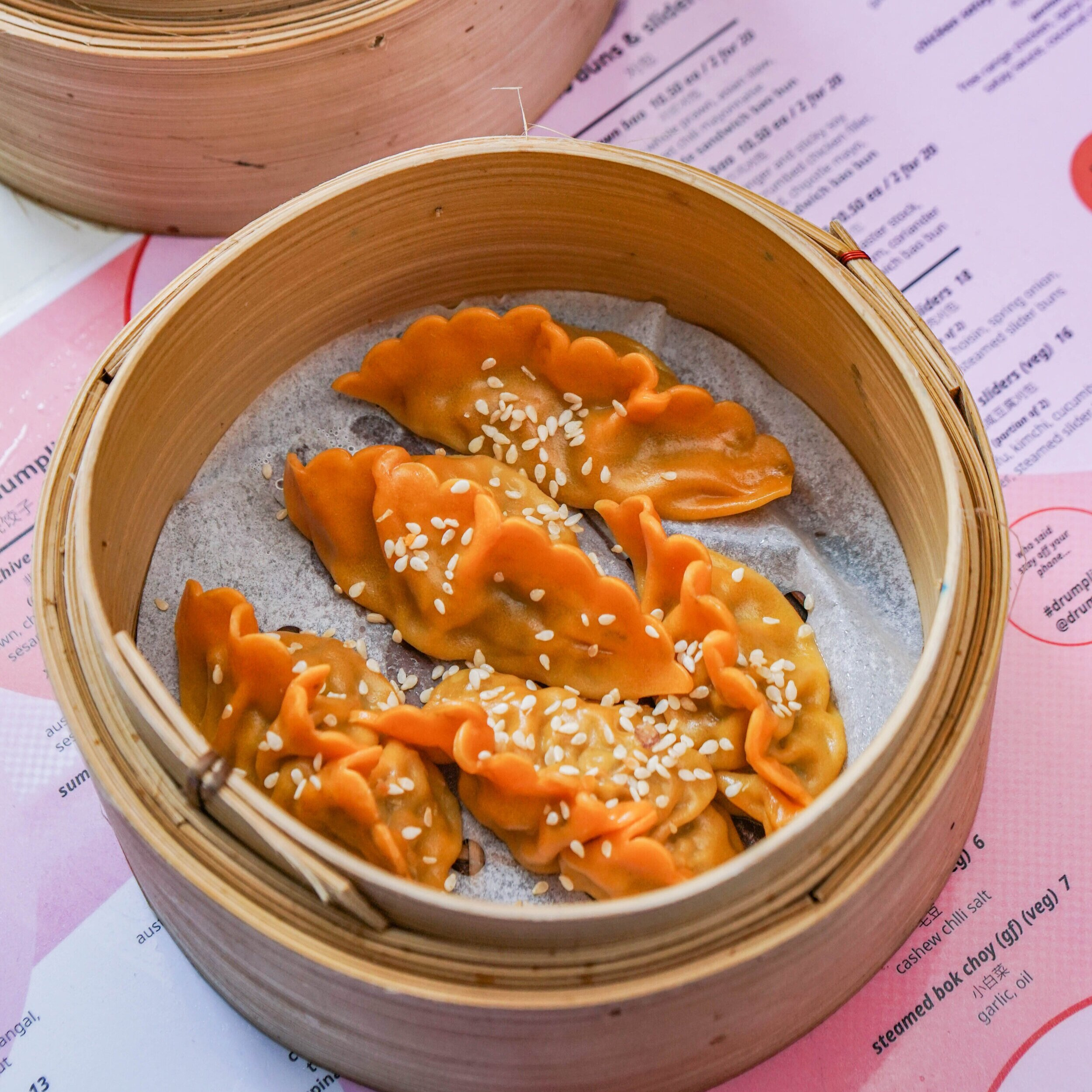 Cheeseburger Dumplings - Our Drumplings superstar. This delicious parcel is packed with fresh beef, melted cheese, pickles, mustard, and topped with sesame seeds. A must try and our most famous dumpling to date!