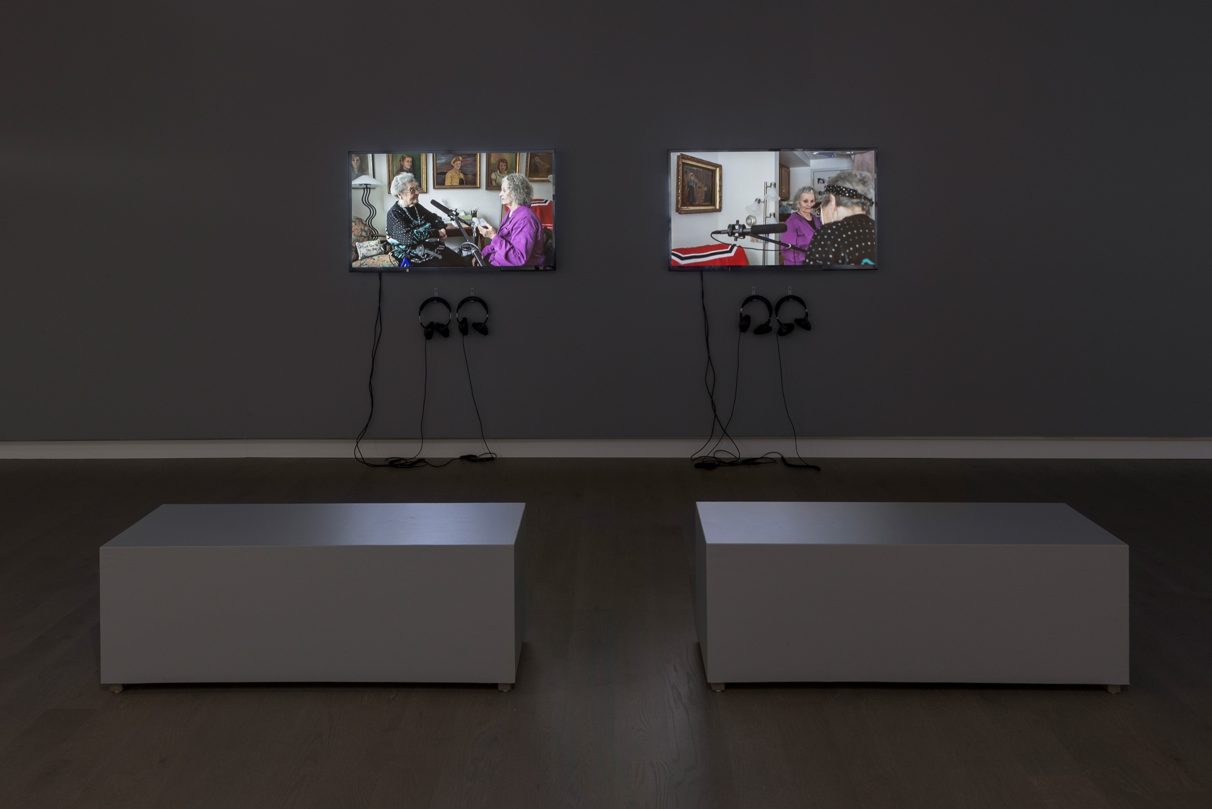 Three Generations (Kodiak Art Club, 1953) , 2014 Left:  Kodiak Art Club , 2014, HD video with stereo sound, 5 min 21s, Right:  Photo from Kutno , 2014, HD video with stereo sound, 5 min 09s  Installation view at Koffler Gallery, Toronto. Produced with the assistance of the Koffler Gallery. Photograph by Toni Hafkenscheid