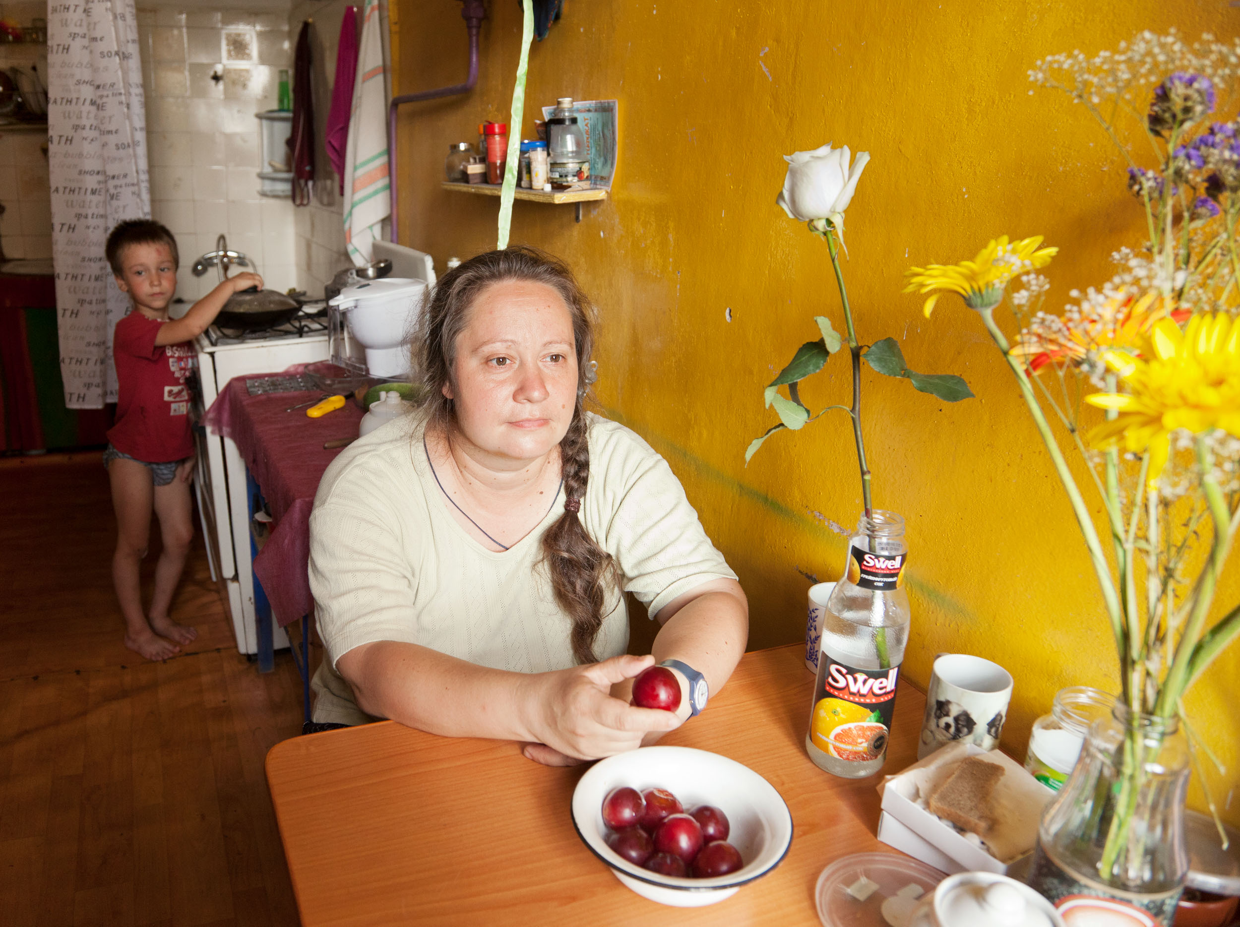 Mother Holding a Plum , from  The Russians,  2011