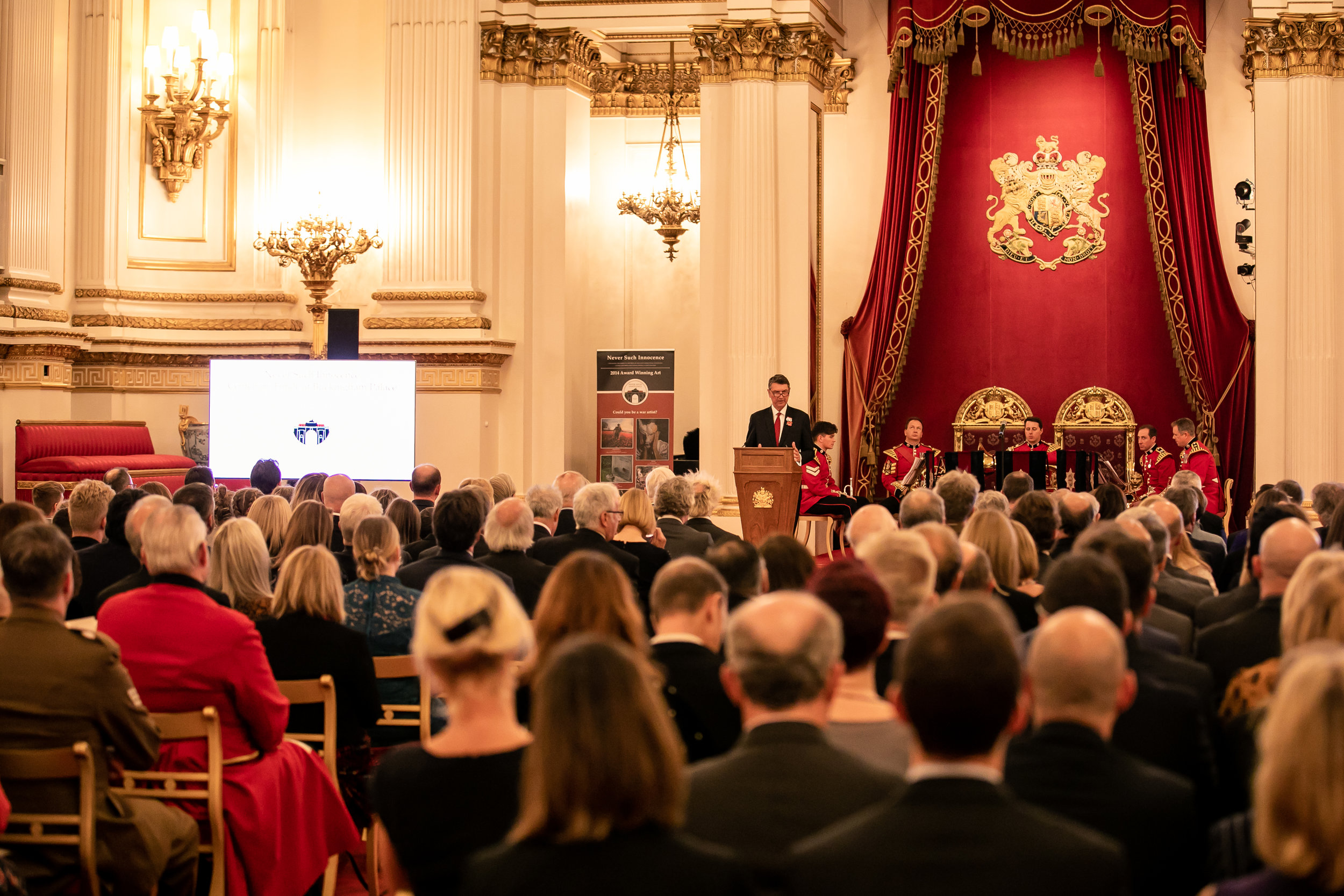 Vice Admiral Sir Tim Laurence, President of Never Such Innocence, addresses winners and guests