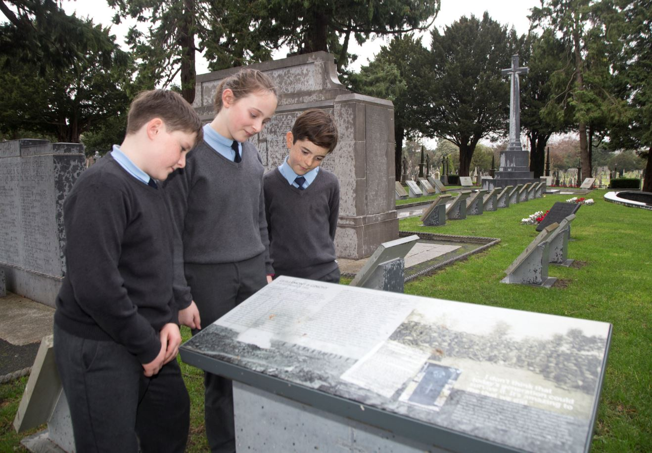 Students visiting the First World War memorial at Glasnevin Cemetery