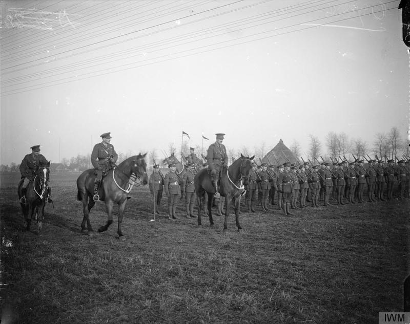 © iwm q 7336 inspection of the regiment after the consecration the king's colours of the royal guernsey light infantry at montreuil, 1919.
