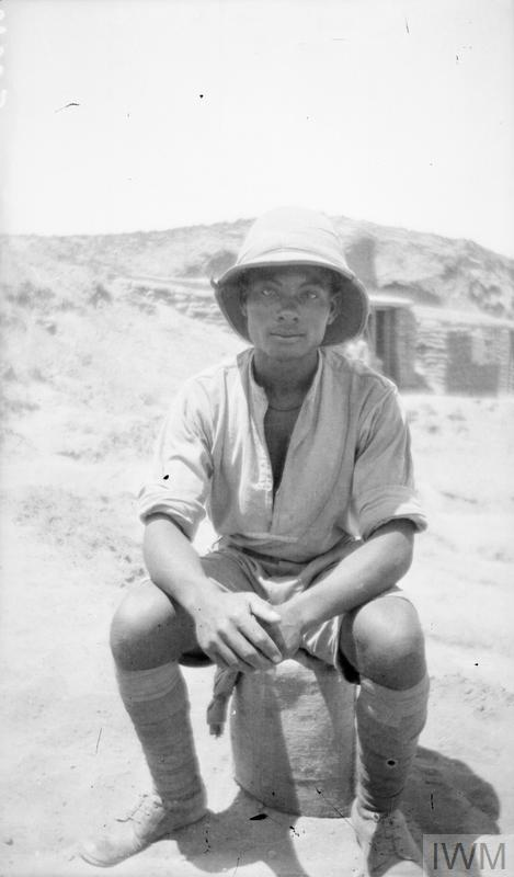 © IWM q 51353 rev h. h. williams. a soldier of the british west indies regiment rest during the digging of a new headquarters for the xxth corps on the cliffs of the mediterranean near deir el belah, palestine.
