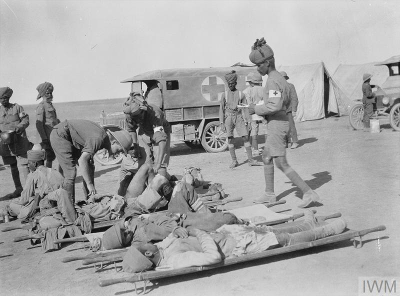 © IWM q 24440 a royal army medical corps officer tends to a group of wounded turks.