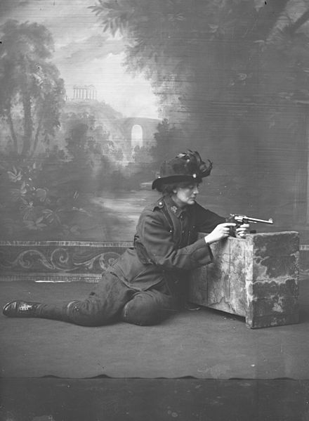 studio portrait of countess constance markievicz in a uniform with a gun.