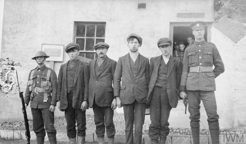 IRA suspects guarded by British soldiers at the Bandon Barracks. © IWM (Q 71708)