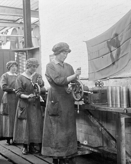 First World War - Female workers adjust the nozzles of shells in the National Shell Factory at Parkgate Street, Dublin, during the First World War. © IWM (Q 33216)