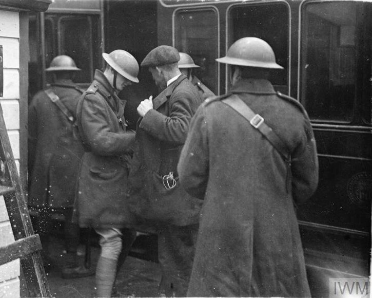 British Tactics - British soldiers searching civilian passengers at Fermoy Station, February 1921. © IWM (Q 107776)
