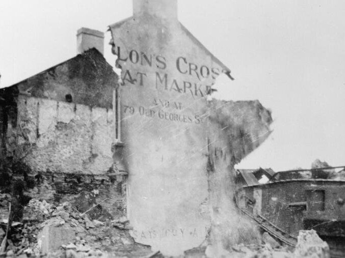 Moves to Negotiate - Remains of Dillon's Cross Meat Market, Cork, after official reprisal. © IWM (Q 107756)