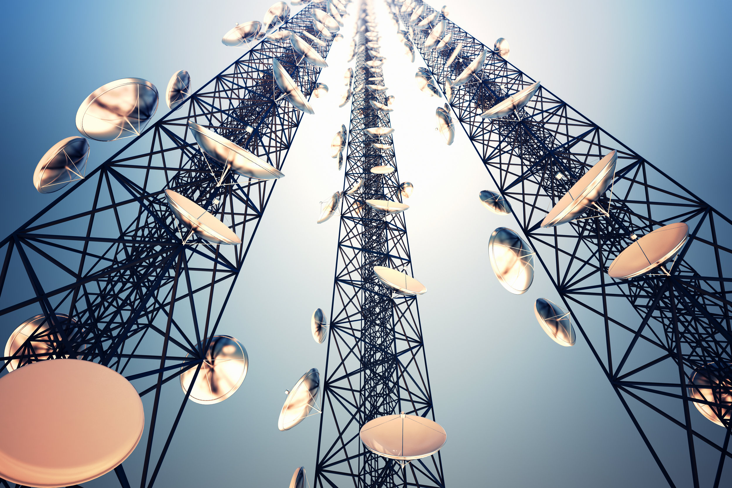 Telecoms tower with dishes above telco cooling by EcoCooling