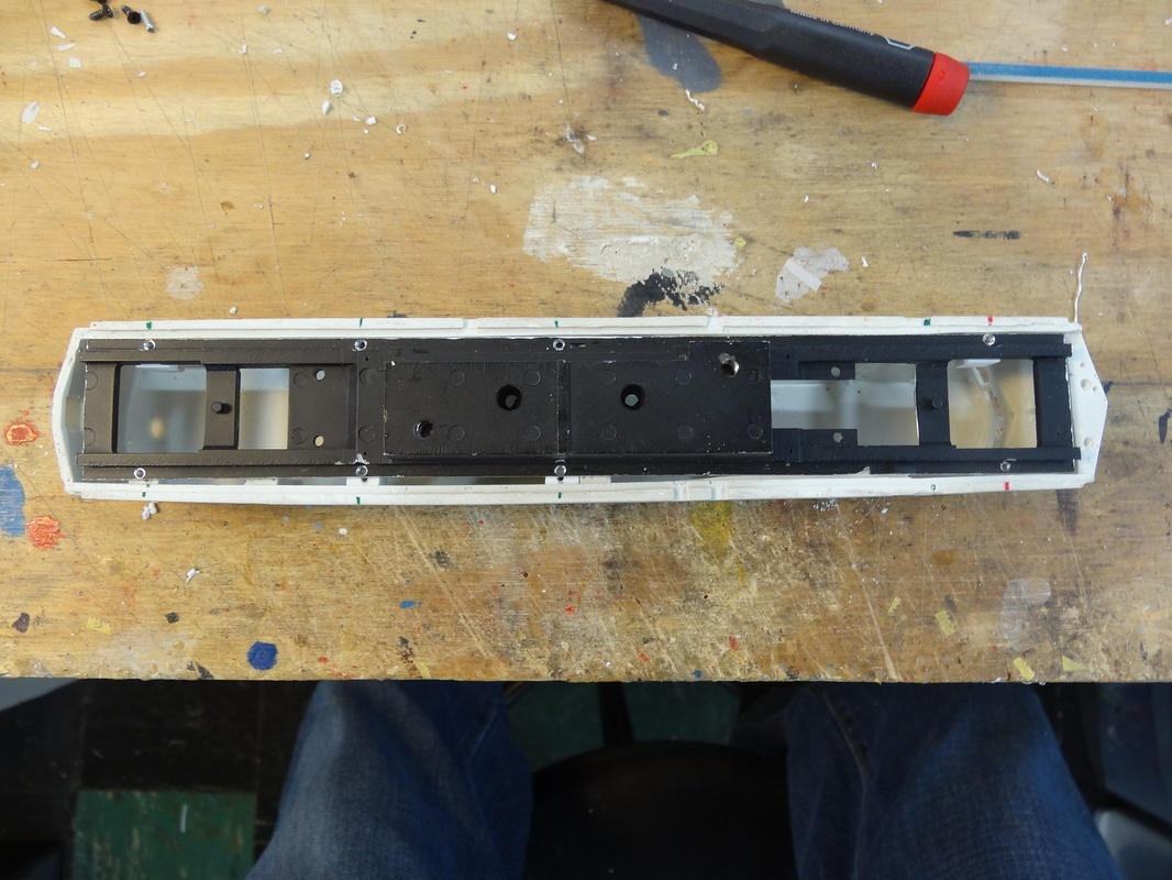 This is how the frame will mount on the shell. You can see here where I cut the coupler mounts off.