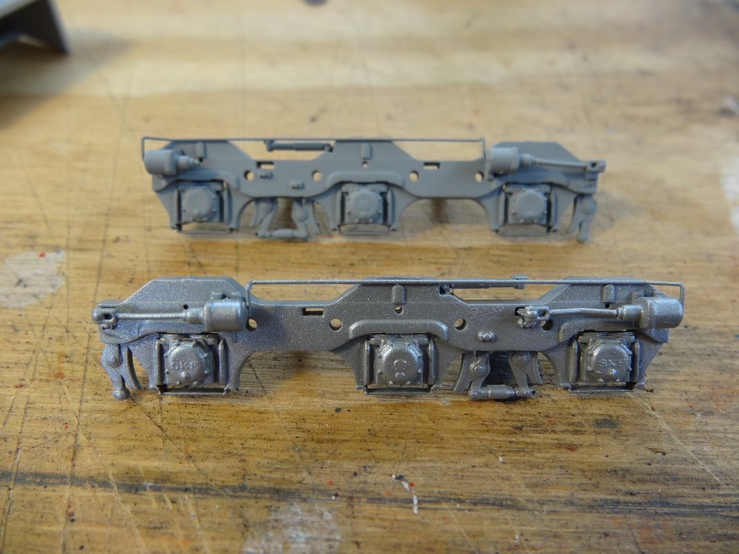 "Here's the sideframes painted silver (I used Model Master Acrylic ""Silver"" for all the silver on this locomotive)."