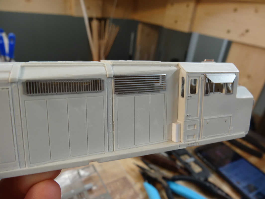 More grilles towards the cab. Note the lack of the big equipment box like the CN's had, the BC Rail's just have a small rectangle. There should be one in your kit there wasn't in mine, so I just used a piece of styrene.