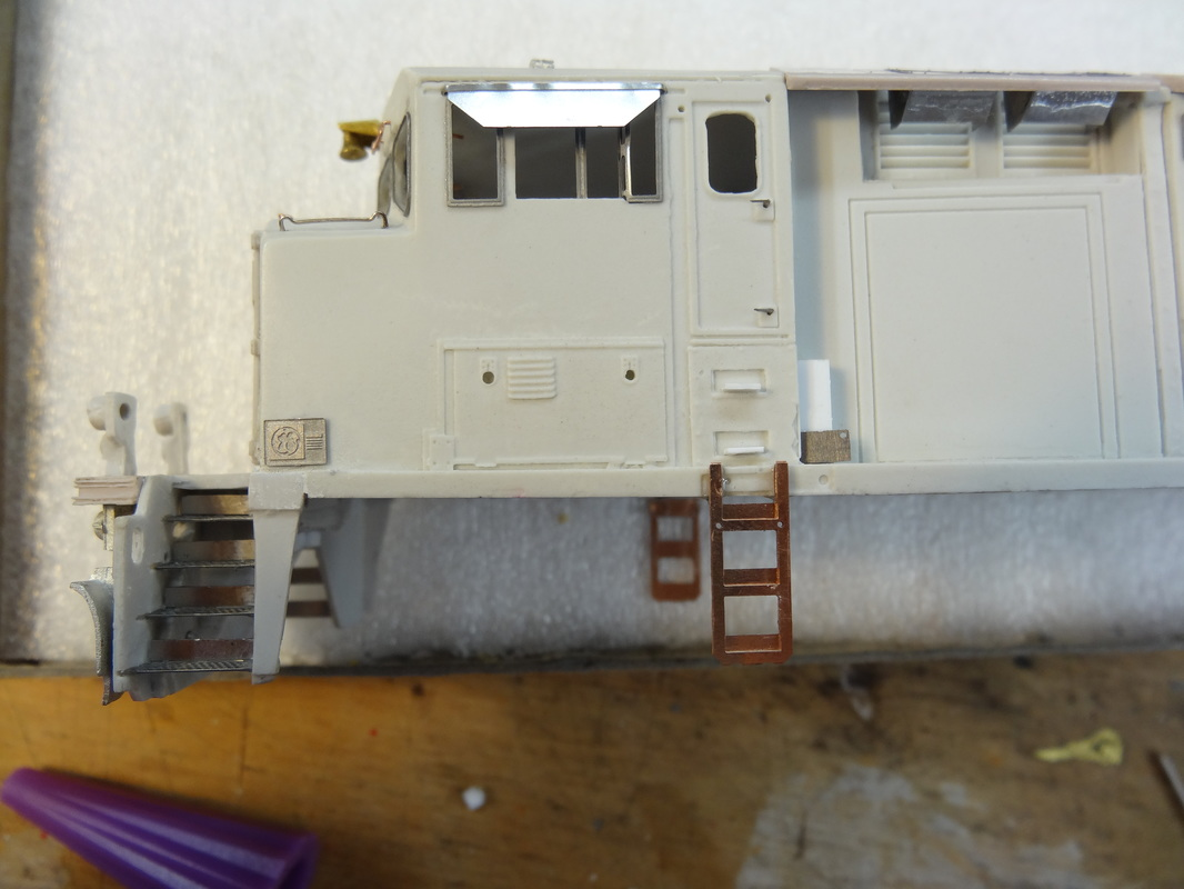 Cab side ladders installed. These are 3-piece photo-etched parts that I glued together. They're supposed to all bend together, but I couldn't figure out how it worked, so I cut them off individually and glued them.