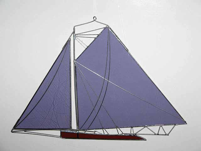 - Jay Smith Glass SailboatsJay Smith handcrafts three-dimensional stained glass replicas of classic sailing ships using photographs, sail plans and drawings of original vessels. His studio is located in Northampton, MA.