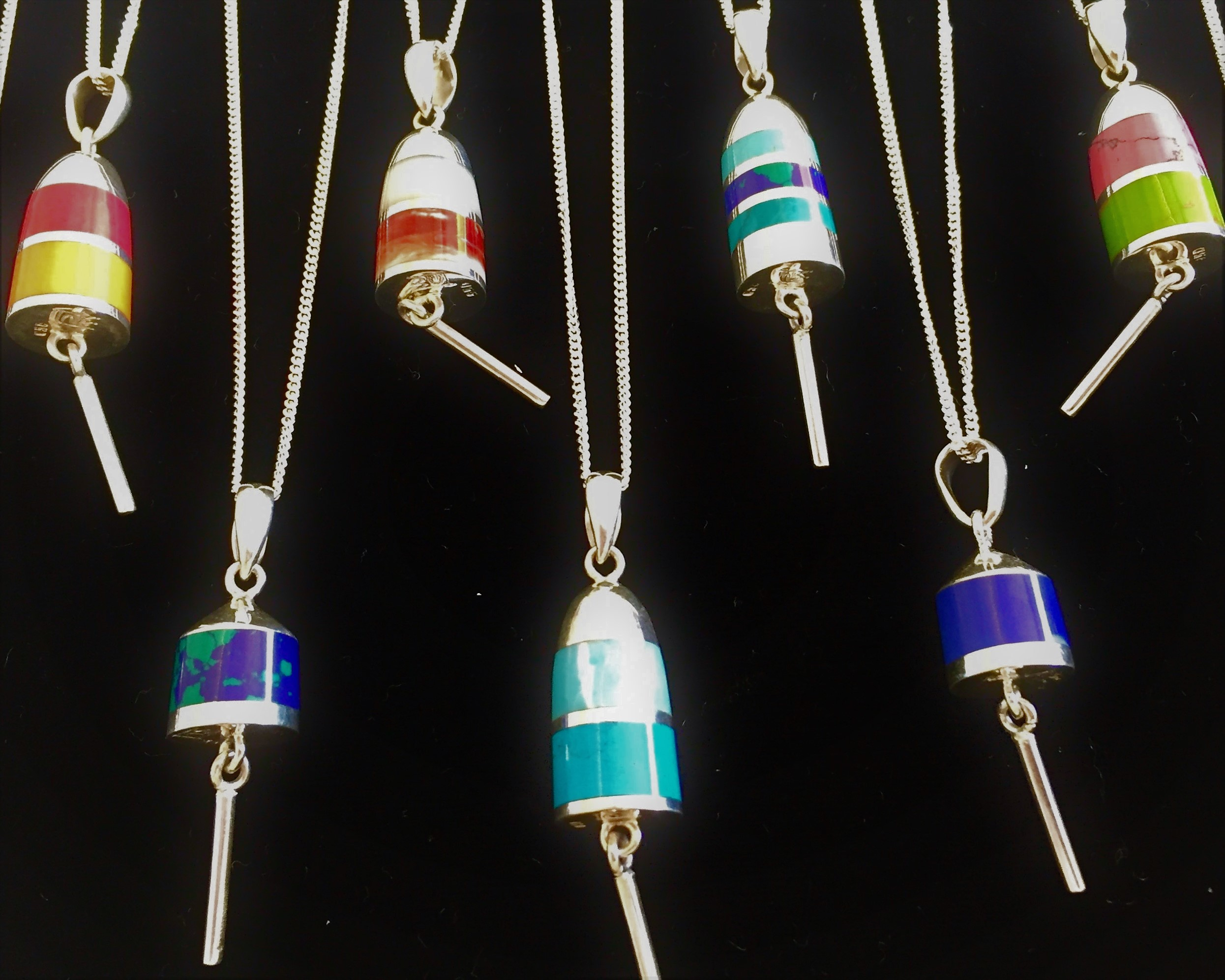 - Cesar Palma creates these beautiful buoy necklaces in silver, incorporating various stones into his work.  These lovely necklaces come to life when worn, with movements similar to that of an actual buoy in the water!