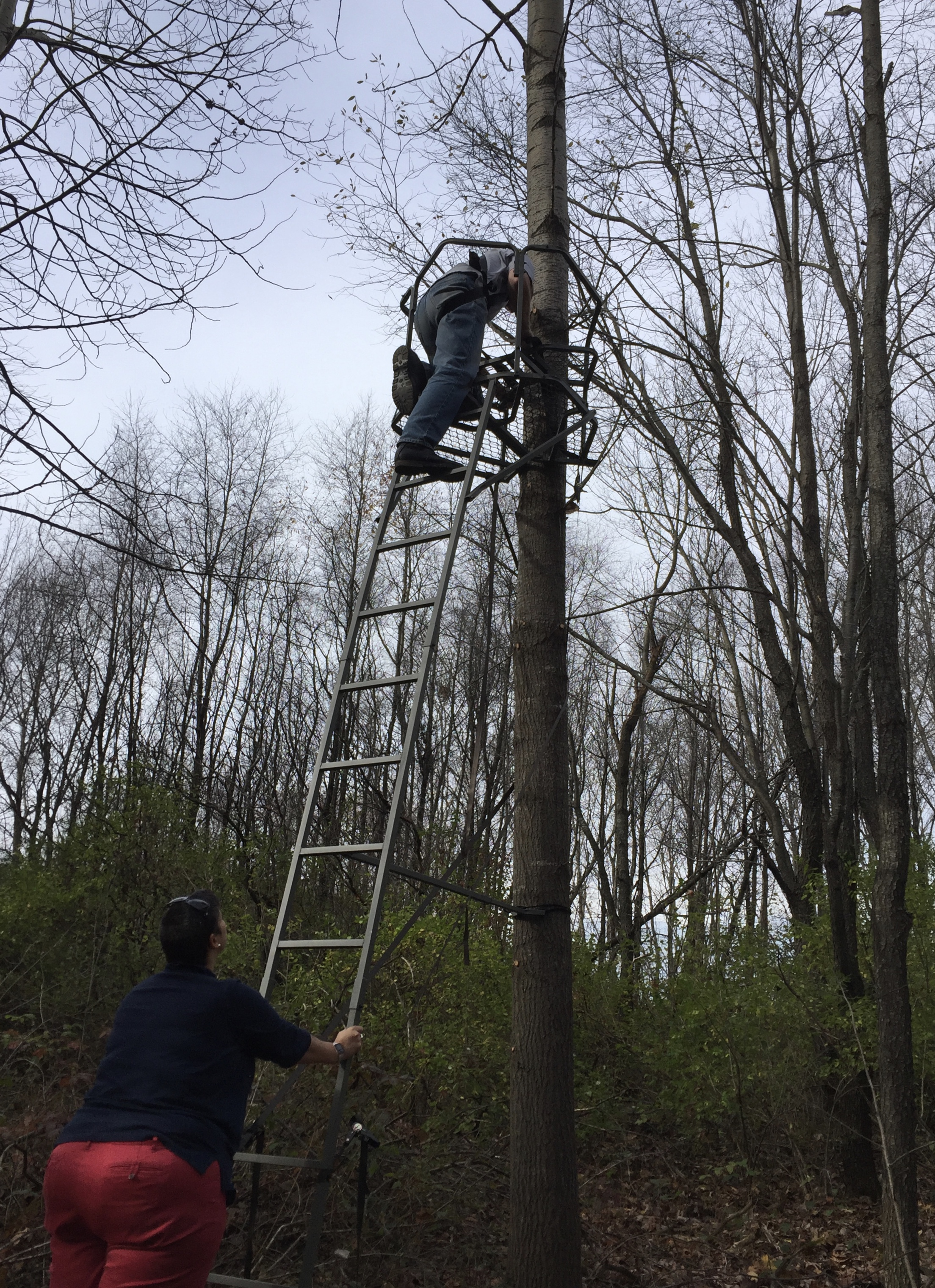 - Our first time installing a ladder stand. Perhaps wearing sandals and red pants in the woods was not my best fashion move (2016).