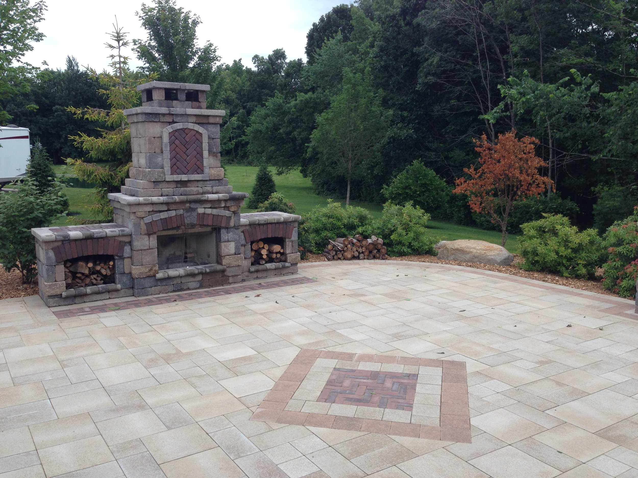 Hardscape - Unilock paver patios, natural stone, walkways, steps, fire pits, boulder walls, landscape stone, edging, and much more.