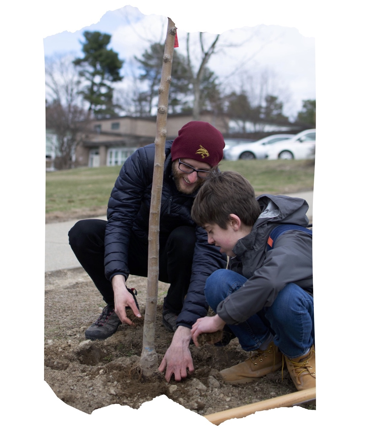 One Bead Program Director, Andrew Stauffer, and a student plant a tree outside of Brown Middle School in Newton, MA.