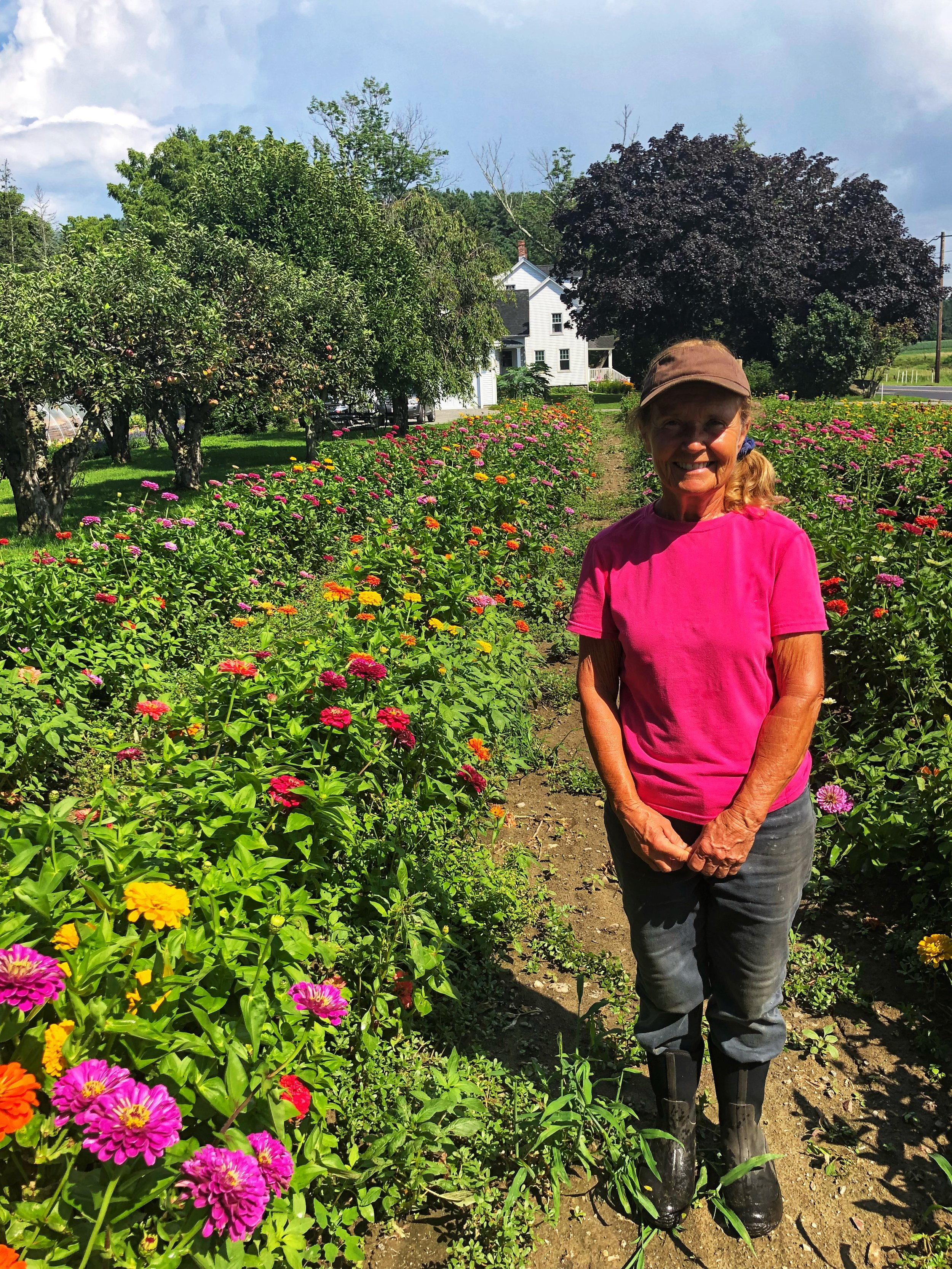 Susan Macone in her field of flowers.