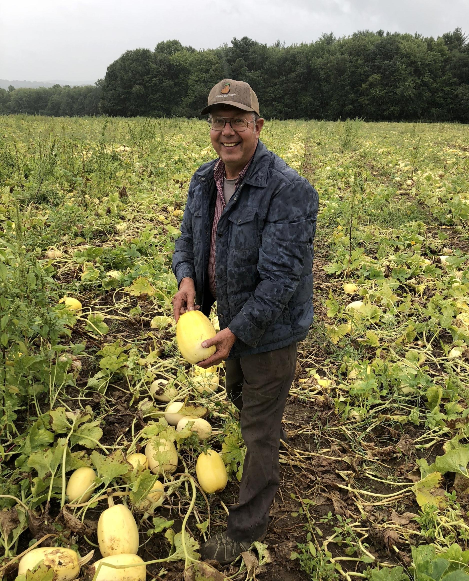 Wally Czajkowski in his field of (delicious!) spaghetti squash.