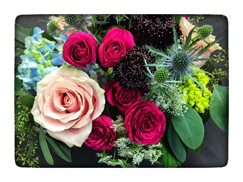 Our Fall Wooden Flower Box with deep reds, blues and pink highlights!