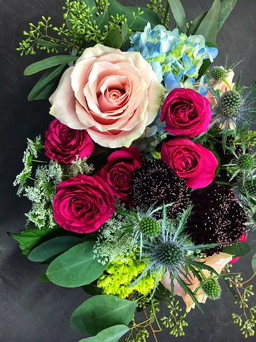 Our florists create custom-made arrangements and bouquets for individuals, groups and weddings.