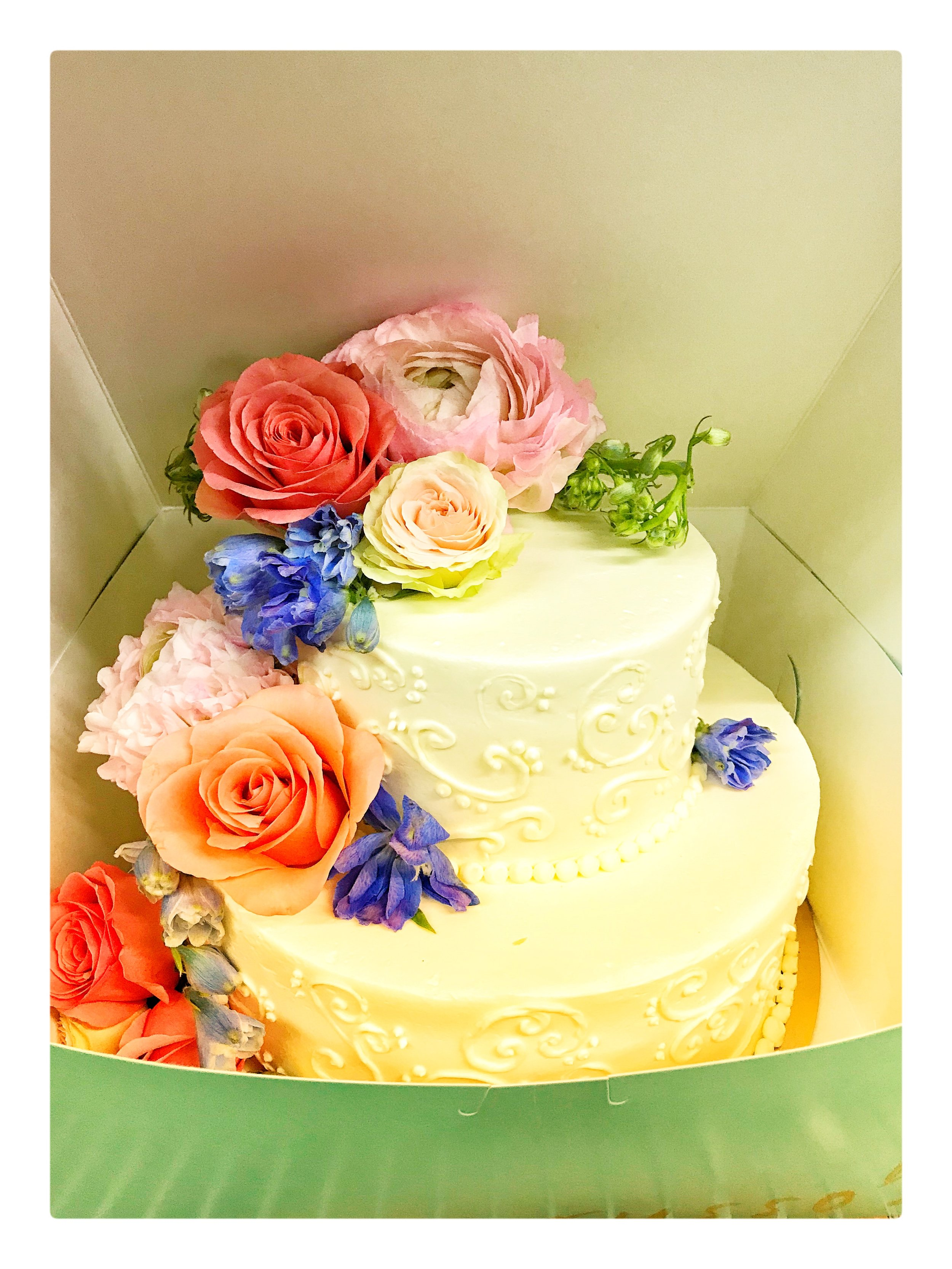 Cake decorated with fresh flowers for a special event in Boston.