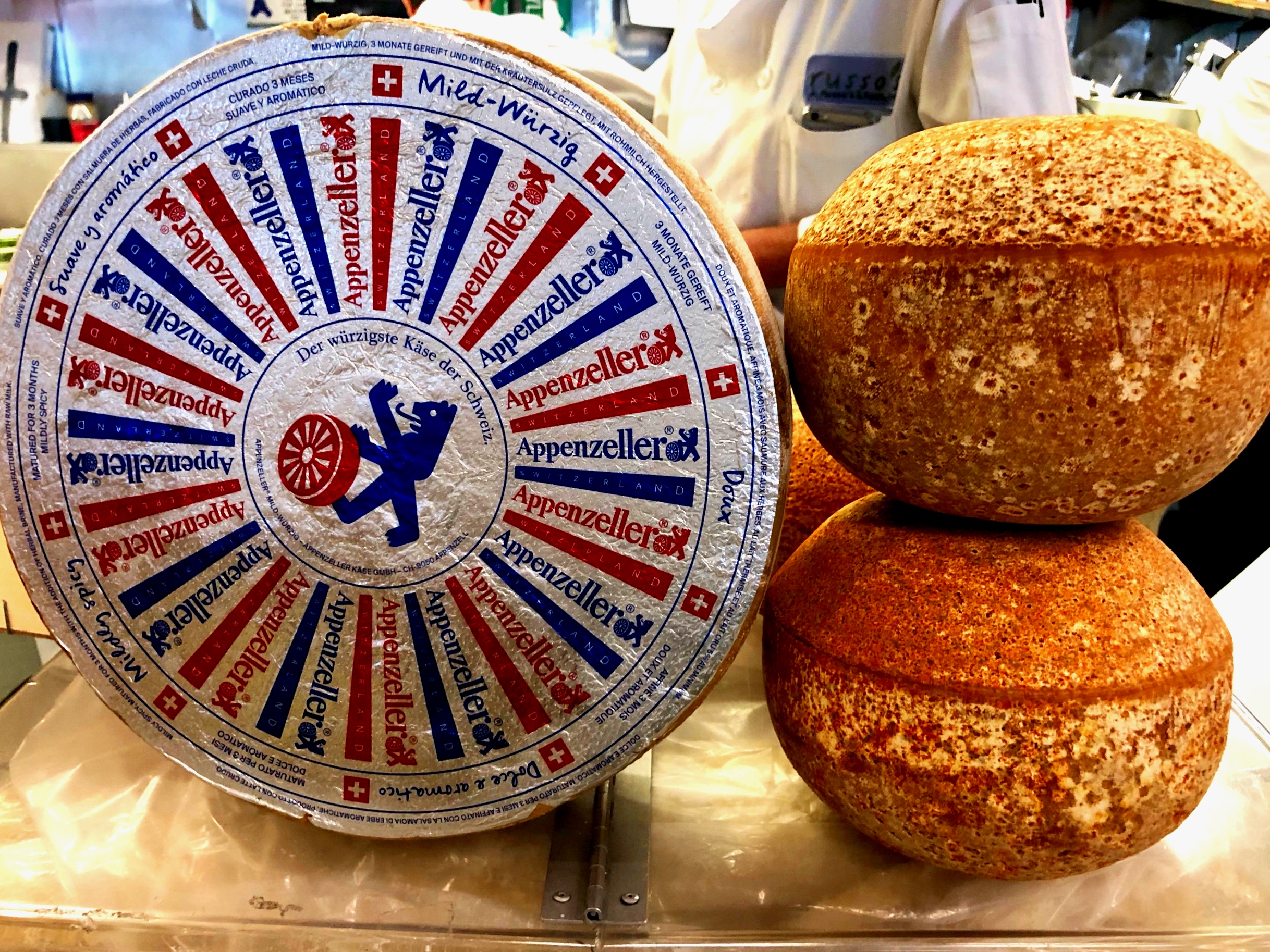 This week's special cheeses, including Mimolette which is one of the more interesting looking cheeses we have seen!