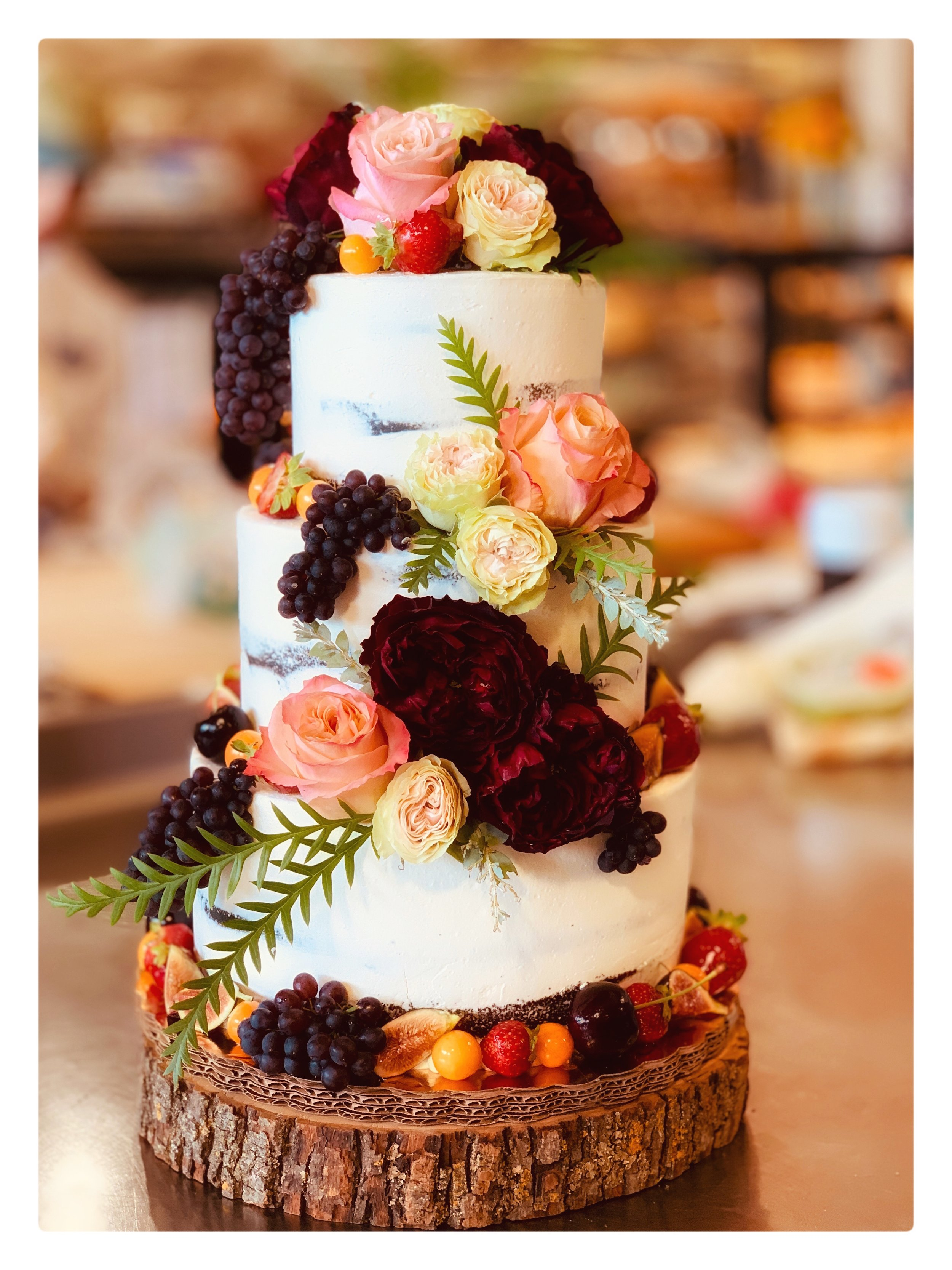 Wedding cake made with fresh fruit and flowers.