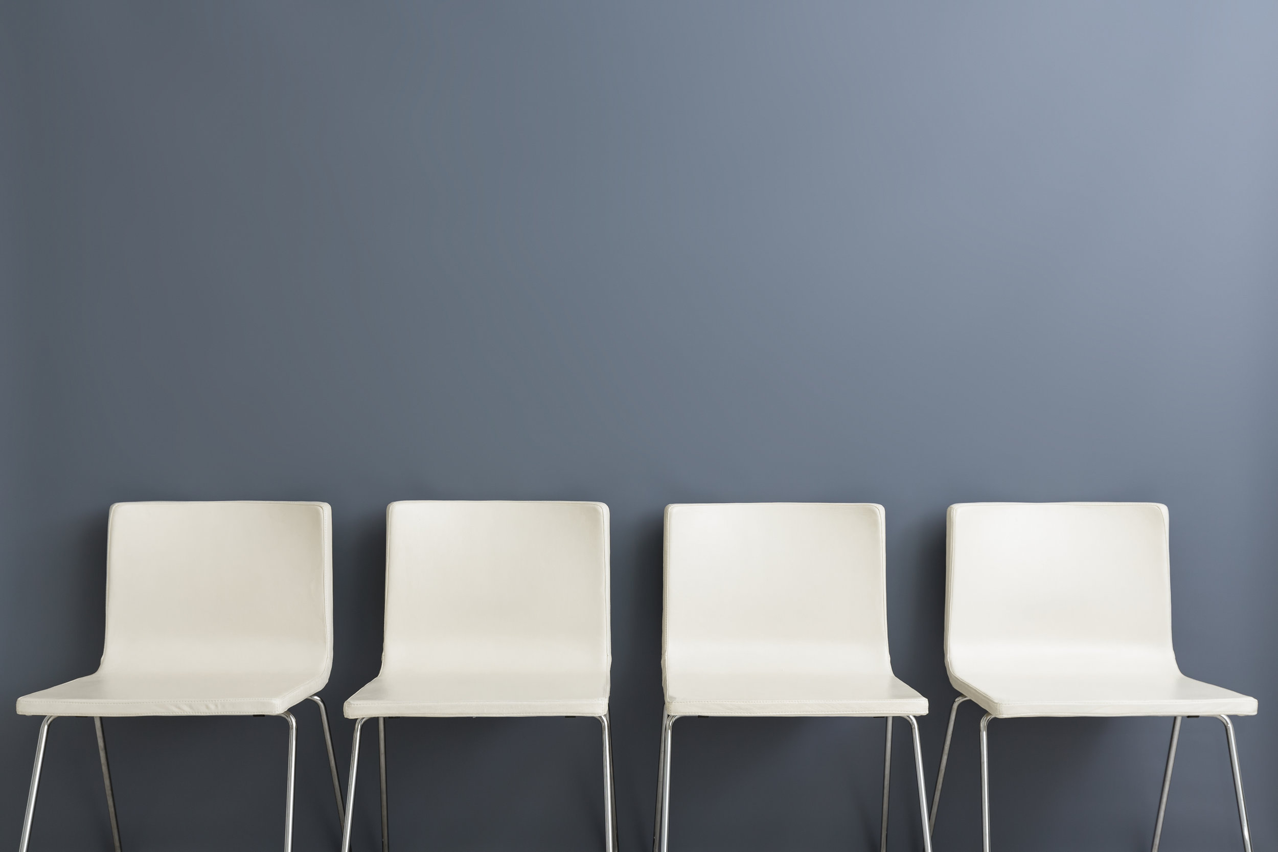 Chair-background-concept---recruitment-hire-hiring-interview-628279378_4697x3131.jpeg