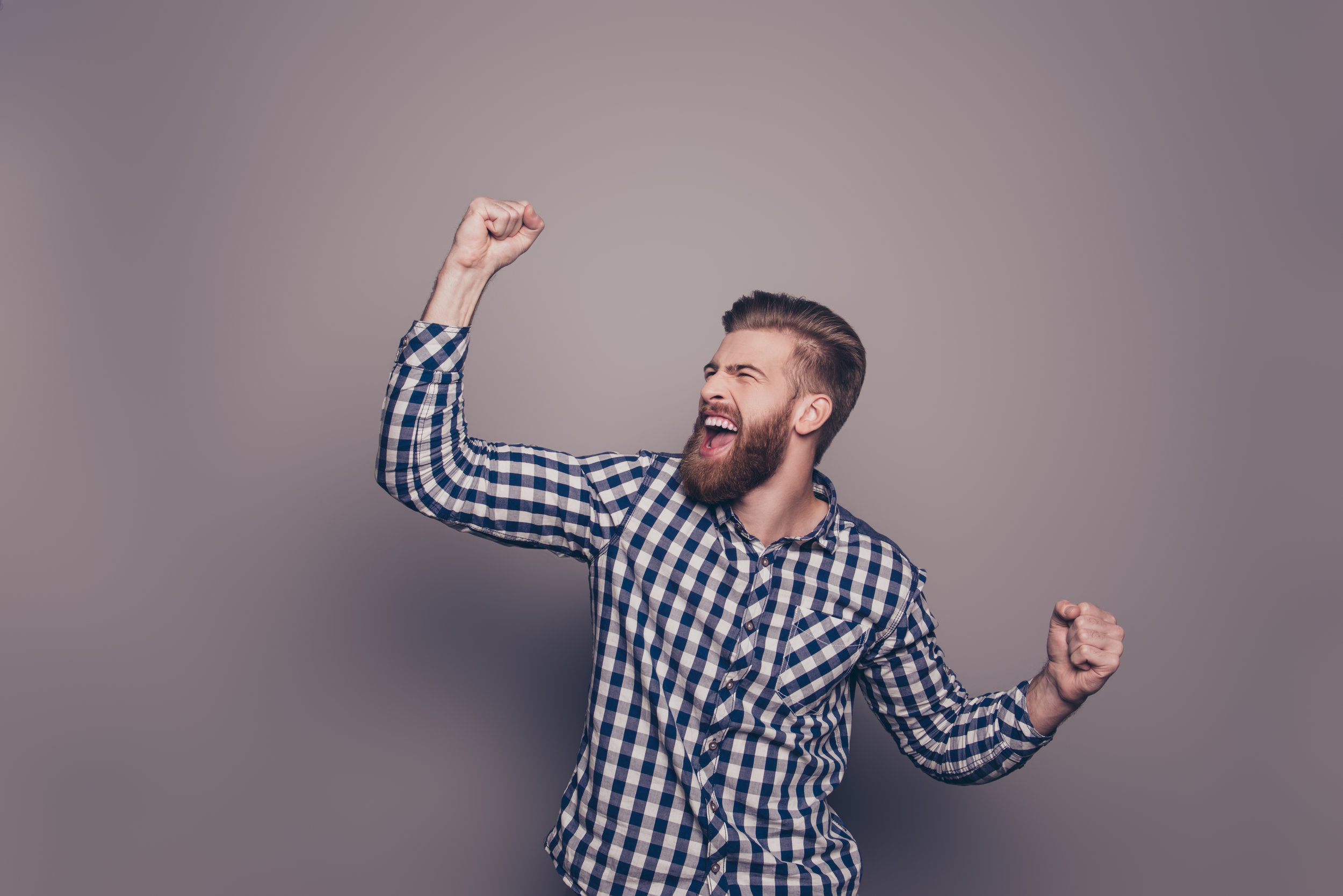 Yes,-he-did-it!--happy-bearded-man-raised-hands-636831346_7360x4912.jpeg