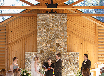 Mary leads a personalized wedding ceremony at Lover's Leap Pavilion in Custer State Park