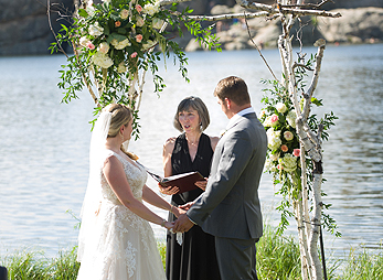 A wedding ceremony at the water's edge, Sylvan Lake Lodge in Custer State Park