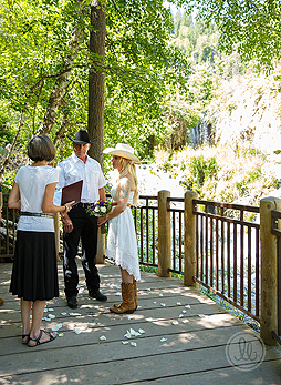 Mary officiating a wedding at one of the viewing decks at Roughlock Falls