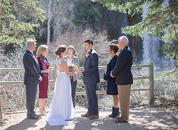A small outdoor wedding at the base of Spearfish Falls
