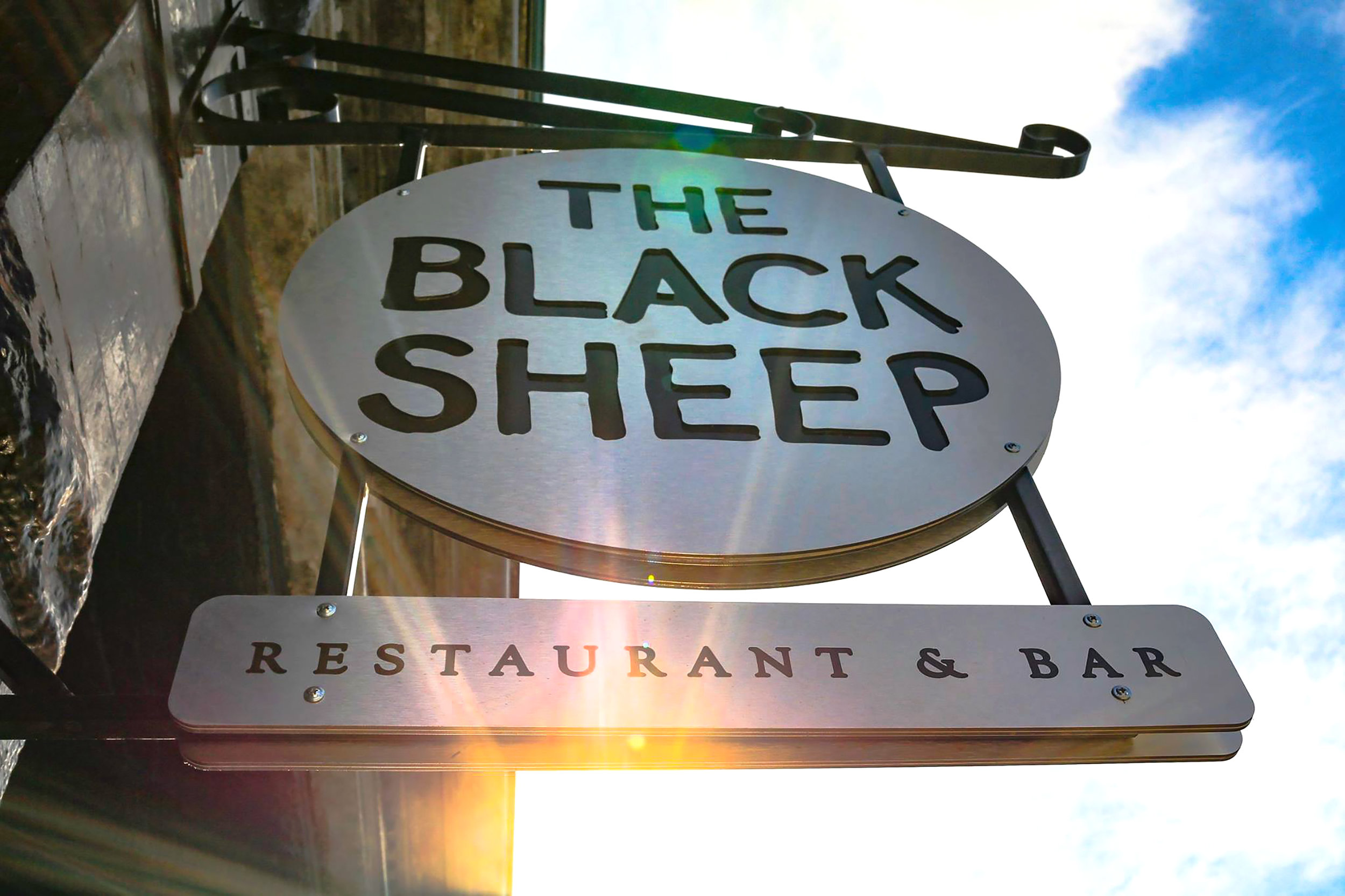 The Black Sheep - Decorative Scroll Bracket Sign with Reflective Graphics and Routed Brushed Aluminum Sign Faces