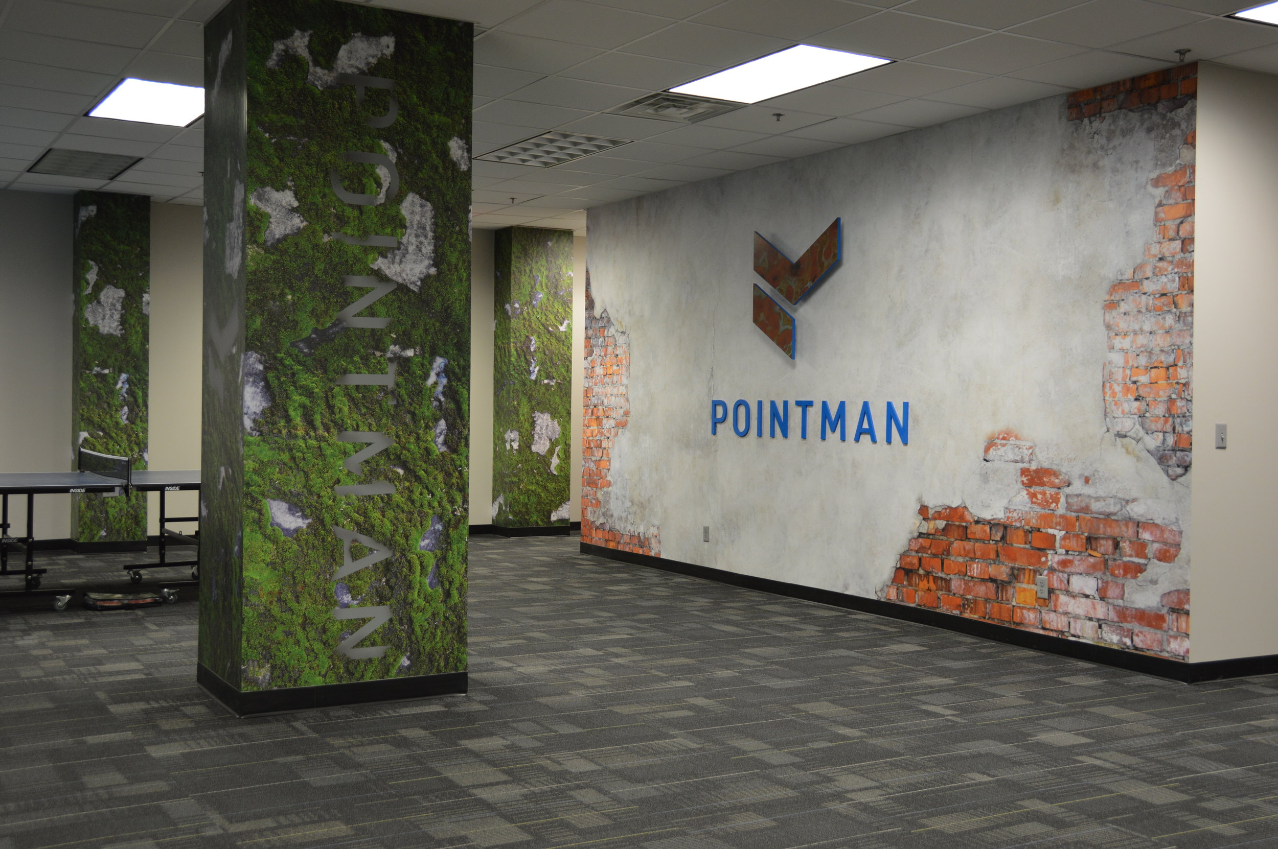 Pointman - Interior Wall Murals and Custom Acrylic Display with Specialty Copper Application on Logo
