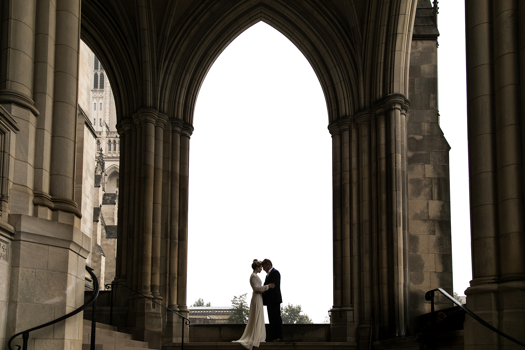 Wedding portraits under the arches of the National Cathedral in DC